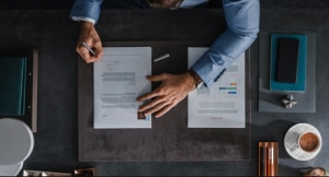 A businessperson sitting at a desk, manually preparing invoices