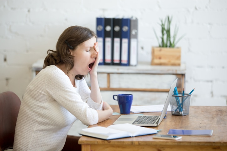 Girl yawning at desk