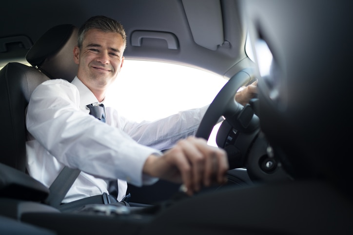 Man in car smiling
