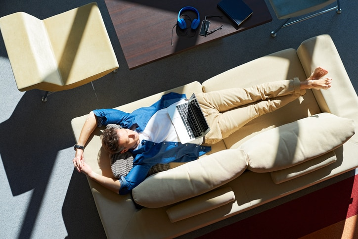Man on lying down on couch