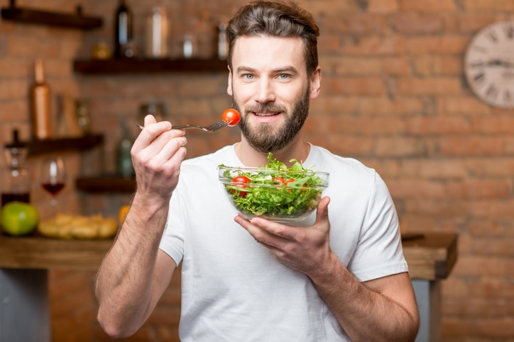 Guy eating a salad