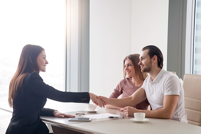 Business woman shaking hands with could