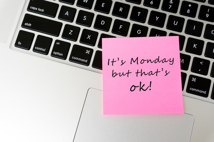 Laptop with post it note that says, 'It's Monday but that's ok!'