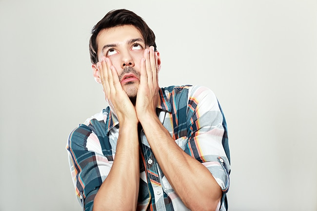 Man with hands on face