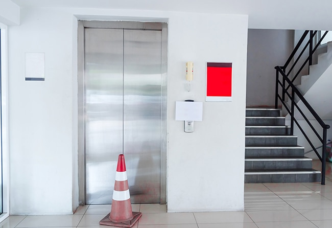 Elevator with orange cone out the front