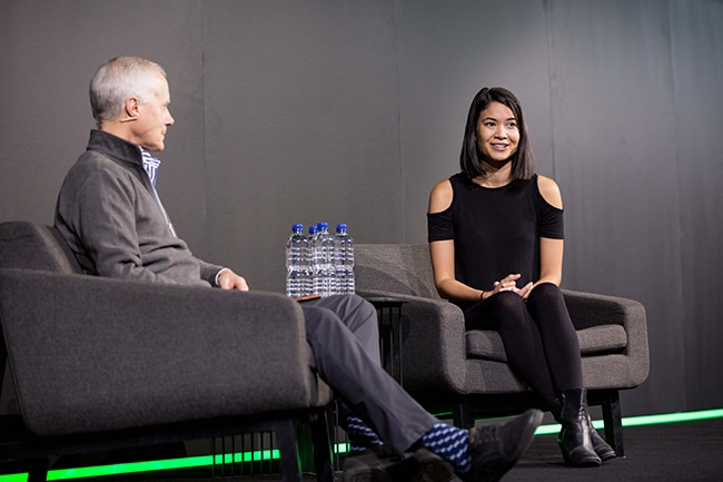 Scott Cook and Melanie Perkins on stage at QuickBooks Connect