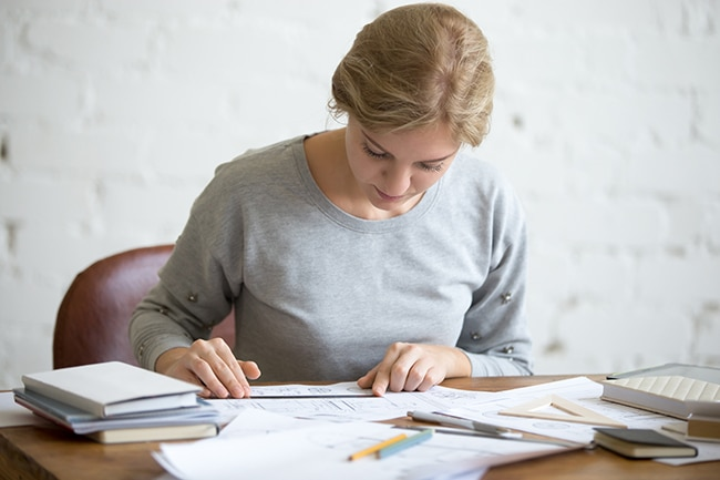 Girl doing paperwork at desk