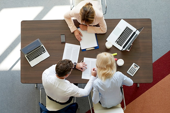 Top view of professional woman consulting with business man and woman