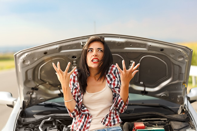 Woman angry because of her car's failed engine