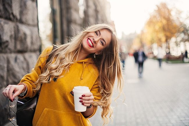 Young girl having a coffee outside