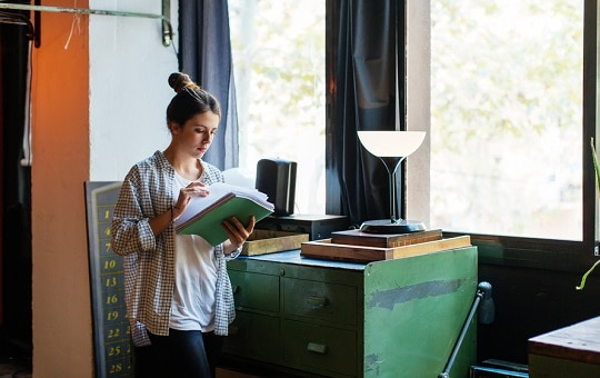 A Woman Reviewing Documents