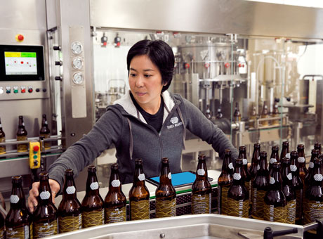 A vendor in the brewing industry preparing products to ship to customers