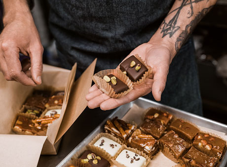 Artisanal baker packs patisseries into shipping boxes for his subscription service