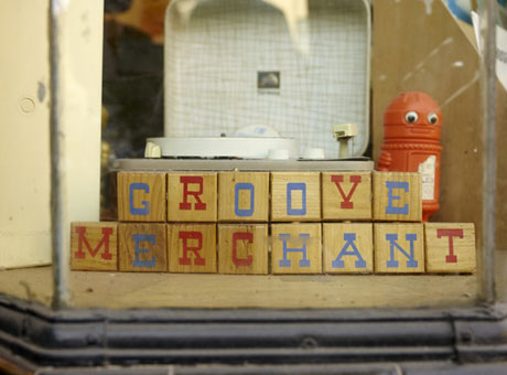 Groove Merchant business name spelled on blocks in retail store display