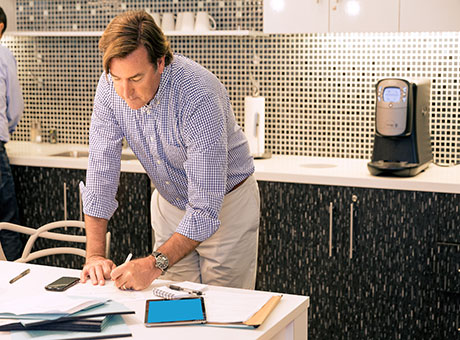 Businessman carefully preparing a business plan as a blueprint for success