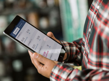 Employer using a tablet to track a client's billable hours