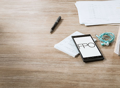 Phone and papers with information on credit invoices