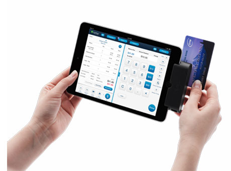 Professional holding tablet on white background with operating expenses and credit card in view