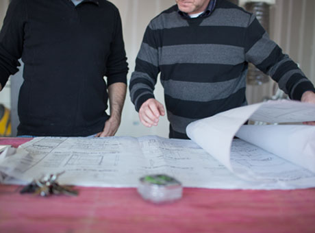 Two contractors viewing Quickbooks data at construction site