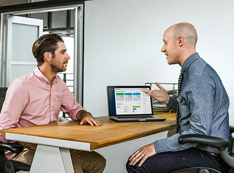 A small business owner meets with a financial rep about his Canada Revenue Agency business account