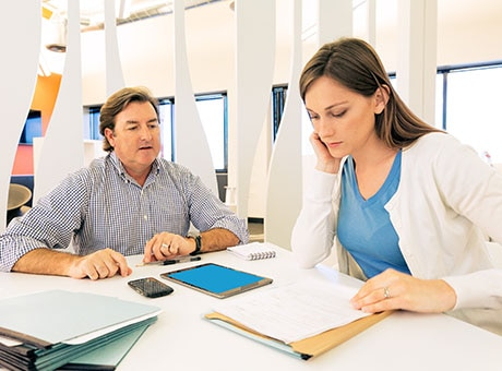 A small business owner reviews a general security agreement with her financial adviser