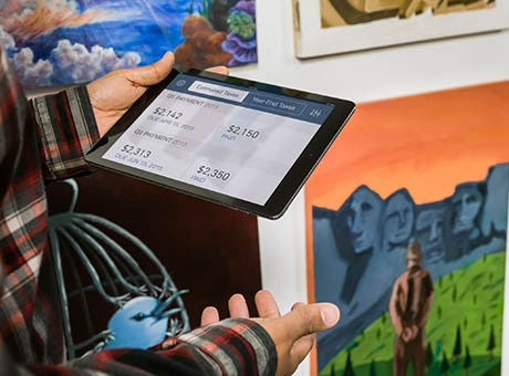 A gallery owner reviews a QuickBooks journal entry