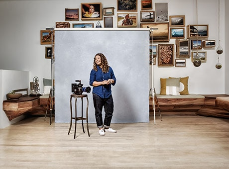 Photographer poses in her photography studio