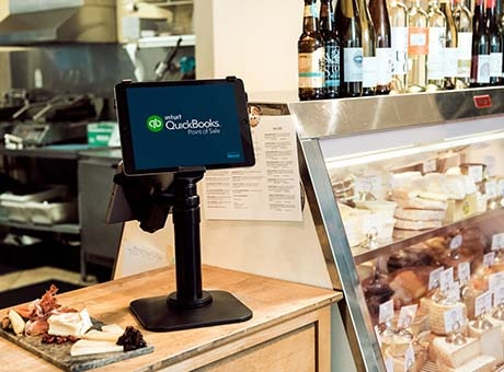 QuickBooks on a register at a co-op deli counter