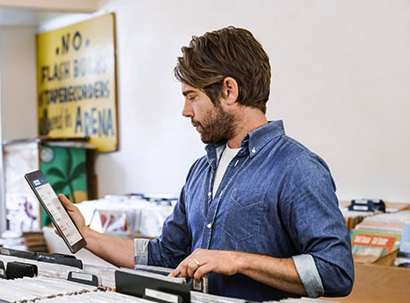 Employee tracks inventory at a record store