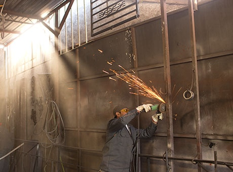 Worker refurbishes a business after a fire