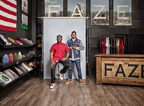 A pair of business owners pose in their retail space