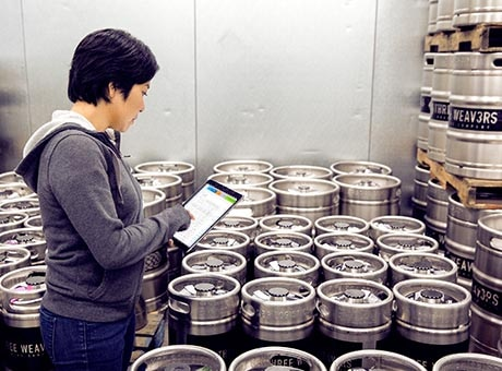 A worker inventories a shipment of imported commercial goods