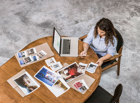 A small business owner finding photographs to add to a blog post