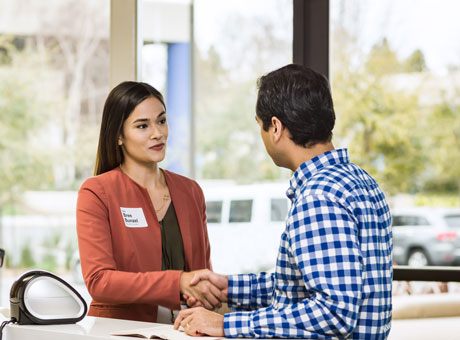 A business owner shaking hand with a client after they agree on a price increase