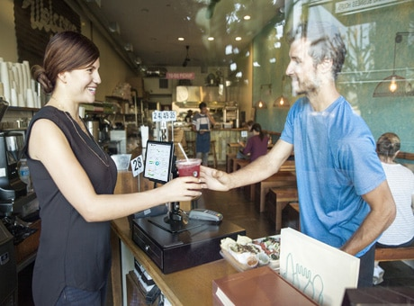 Franchise Business Owner Serving Coffee to Customer in Her Coffee Shop