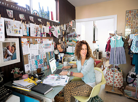 Home-based employee discusses company dividends in home office near interior designer supplies