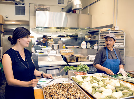 Restauranteur talks to her chef about increasing scale of production but without additional