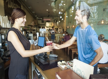Successful Business Owner Serving Coffee to Customer in Retail Store