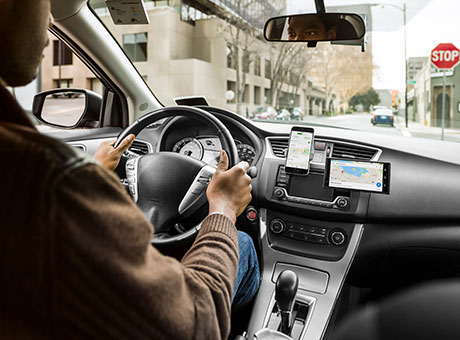 Uber driver in vehicle with smartphone displaying bookkeeping records