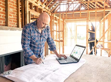 An architect works remotely from a construction site