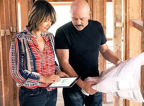 Business owner reviews office remodeling plans with contractor