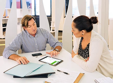 A pair of business owners create a company master budget