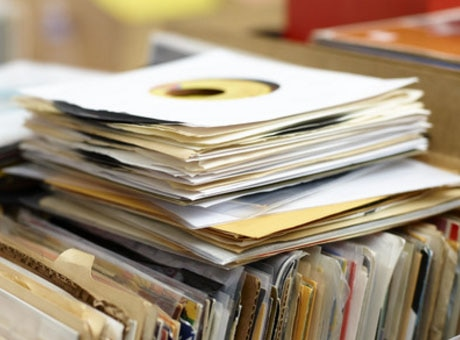 Closeup of a busker's record collection