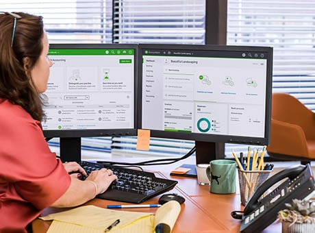 A corporation's bookkeeper manages company expenses on a computer
