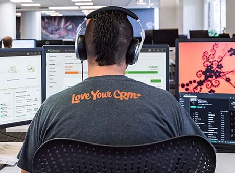 An employee completes work with open source software