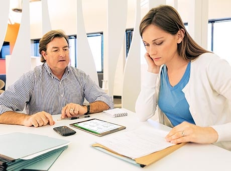 A new employee reviews a non-disclosure agreement with her hiring manager