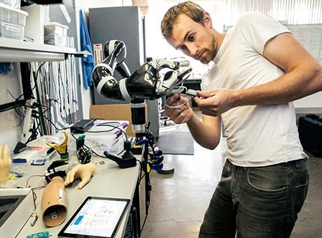 An employee works on a company's innovative artificial limb technology