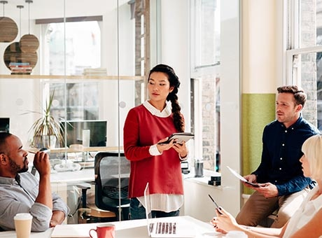 Employees collaborate on equal terms in a business operating as a holacracy