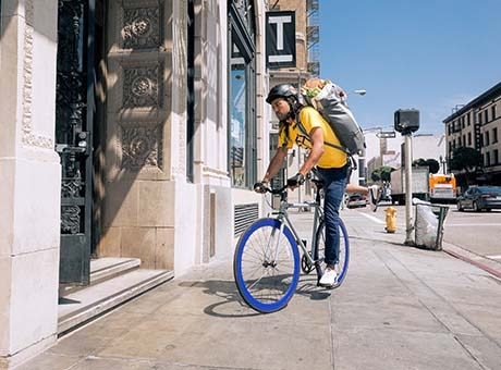 A fitness professional arrives at work on a bicycle