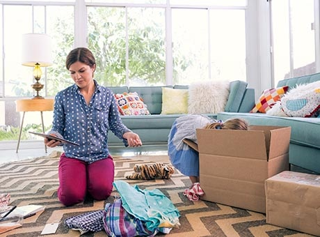 Home business owner packs supplies for relocation to commercial space